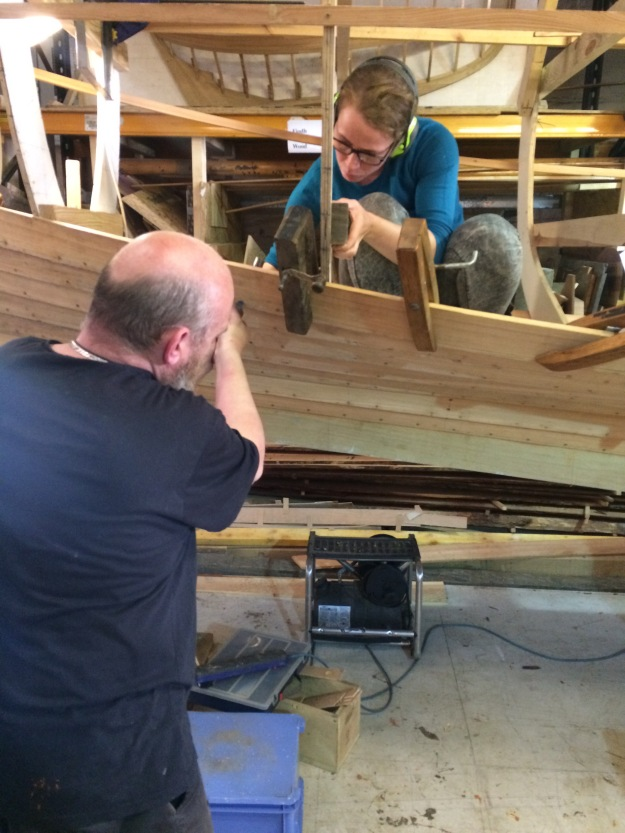 Catherine and Brian have been working solidly to get the planks on the West Coast Skiff